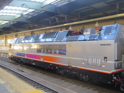 [New York]New Jersey Transit have recently followed in order to run through trains to New York Penn from non electrified routes that join the electric main line. Through bi mode trains run from rhe Midtown Direct, the Rariton  Valley and  Jersey Shore line using new but extremely large  and heavy Bombardier bi-mode locomotives. One is pictured here at Newark Penn station. Formerly these trains had to run Hoboken for the ferry or PATH for New York or terminate at Newark.