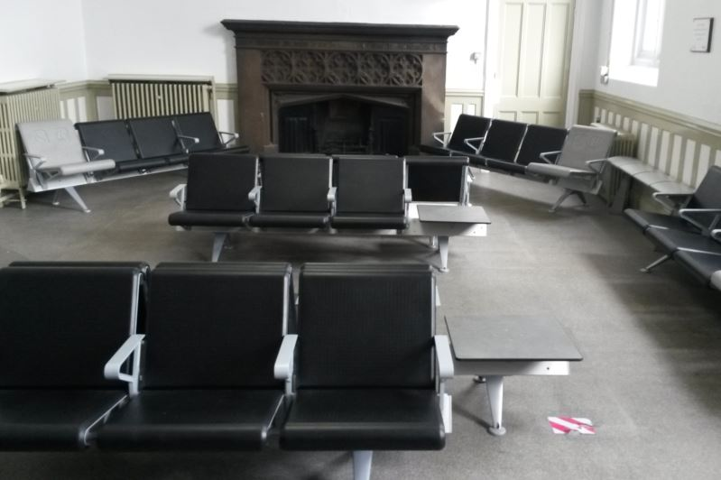 Carlisle station's waiting room, which still has a fireplace, has filled the room with plenty of seats and adjacent tables. Often the tables, ideal for placing a cup of coffee, are forgotten