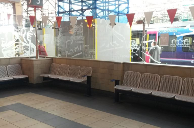Although many stations have seats those close to the platforms are often noisy and people are constantly walking past. At Carlisle station there are several enclosed seating areas with glass to minimise the noise but let in the light allowing people to relax. Missing are tables and power-points