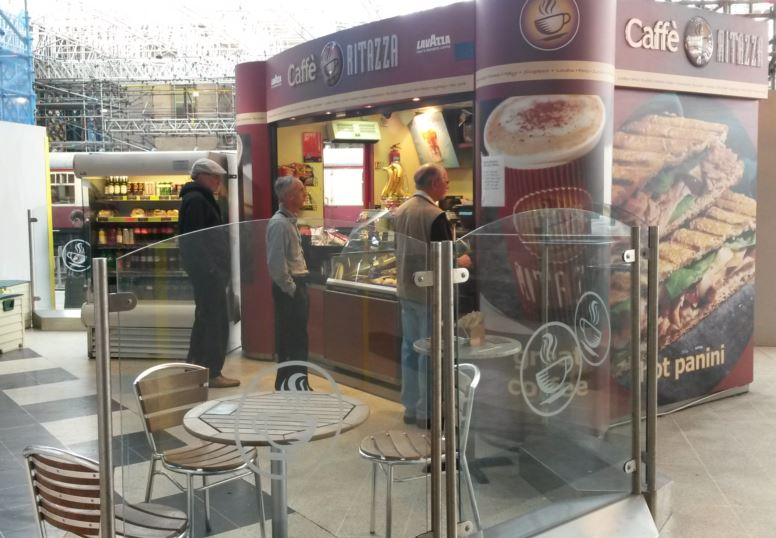 Carlisle station has several places where refreshments can be purchased. This coffee kiosk has seats and tables with glass to minimise the noise from people passing by