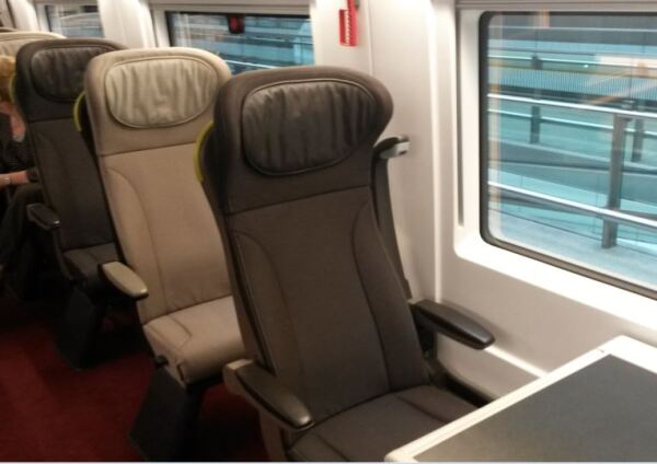 [Eurostar]Row of single seats in Standard Premier class on brand new Eurostar e320 train introduced into service in late 2015 and standing at platform in St Pancras International station