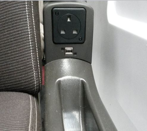 [Eurostar]The new Eurostar e320 trains have the power sockets (which include USB sockets) hidden discretely under arm rests rather than on the wall like the older e300 trains