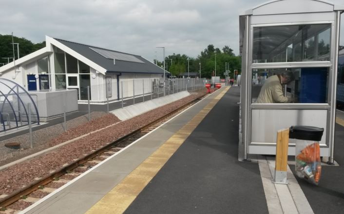 [Borders Railway]A good-quality staff building was built in the car park at the Tweedbank terminus of the Borders Railway line but rather than extend it to provide warm waiting facilities and toilets for passengers, they get nothing more than a waiting shelter on the platform