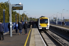 Passengers board the Chiltern Railways train at Oxford Parkway on the opening day of this new station in October 2015 as it prepares to depart for London Marylebone thanks to a brand new chord to join the Chiltern Main Line