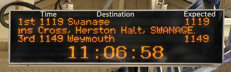 Train destination screen on platform shows the first train to Swanage on opening day 13 June 2017