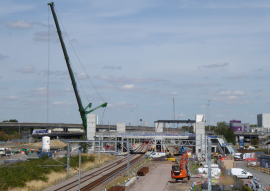 Photo of the new Meridian Water station being constructed (with large crane in shot) in 2018. Railfuture supported closure of the barely-used nearby Angel Road station, which it effectivey replaces