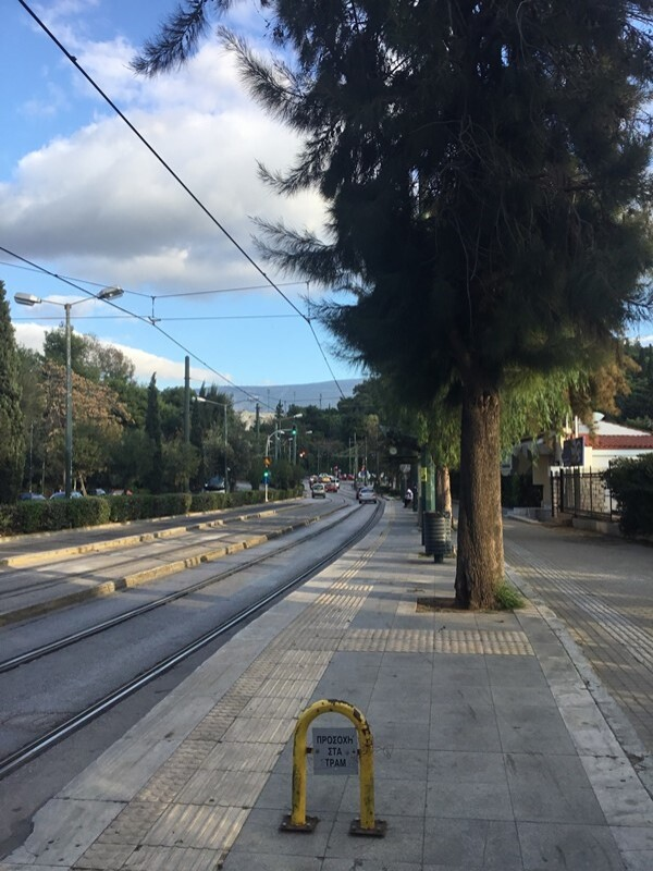 Difficult to believe that this is near the centre of Athens where one lane of a dual carriageway has been replaced by the tram the dual carriageways of Birmingham( would lend themselves to this treatment. Network Rail clearly did not design the catenerary!