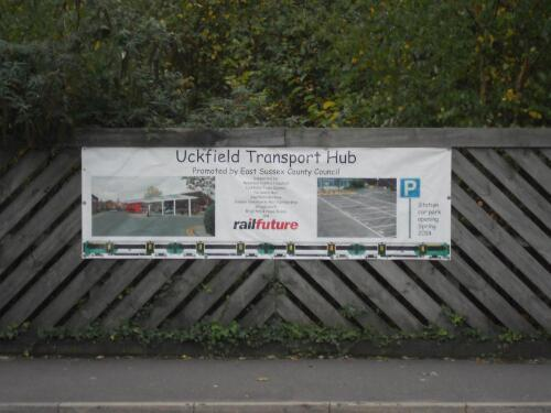 Close-up photo of the Railfuture banner fixed to the fence at Uckfield station to promote Railfuture's campaign to reopen the Uckfield-Lewes railway line