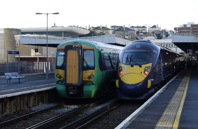 Wider shot of two trains at Hastings - one is the first Javelin to visit Hastings and highlights Railfuture's campaign for HS1 services to Hastings and Bexhill